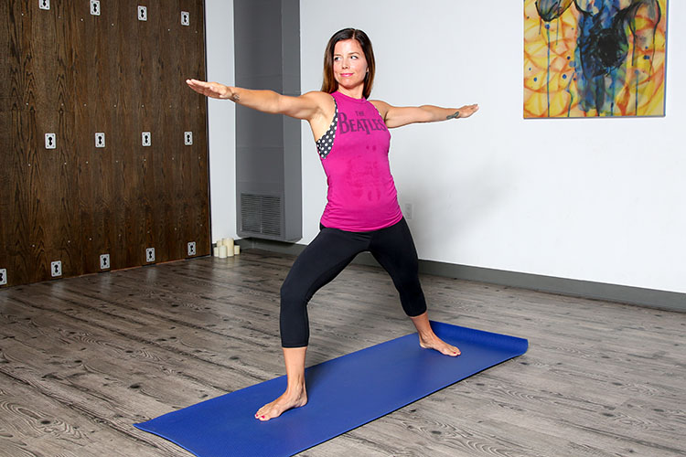 For sessions at Ekam Yoga, Deserie Davis cuts the sleeves off old T-shirts so she can easily take it off as she transitions from pose to pose.