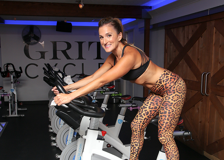 At Grit Cycle, Cassie Piasecki matches neutral shoes with crisscross sports bras and fitted leggings in a quick-drying fabric.