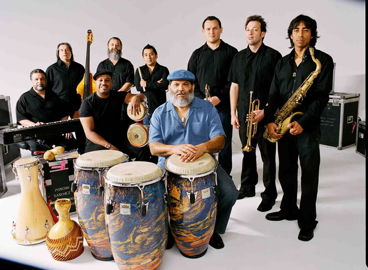 Pancho Sanchez (in blue) and his band