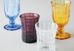 The curlicues on Juliska's COLETTE GLASSWARE small glasses and goblets add a vintage-inspired aesthetic, while the rich colors are sophisticated enough for an adults-only evening, $100 for a set of four glasses, $128 for four goblets, at Neiman Marcus, Fashion Island. (949-759-1900; neimanmarcus.com)