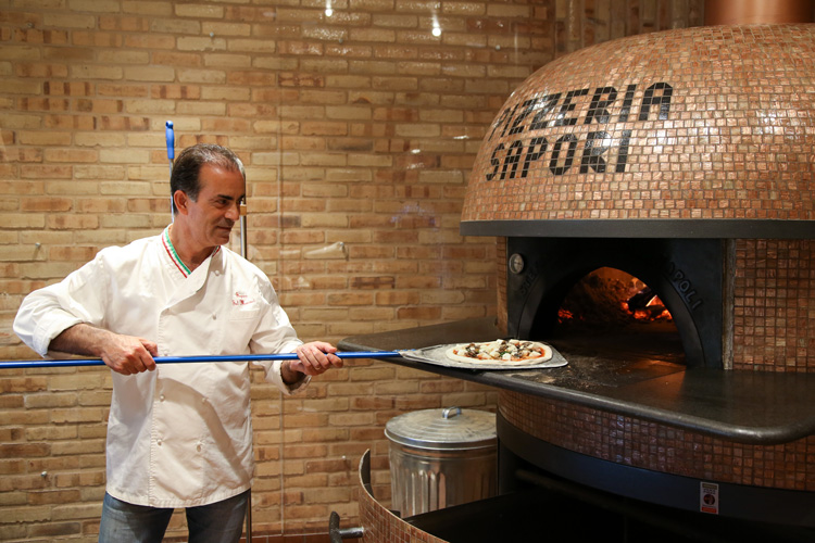 Pizzeria Sapori chef-owner Sal Maniaci meticulously prepares the dough before it's fired in an imported oven.